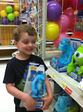 Photo: I asked him to smile at me for a picture, but he couldn't tear his eyes off of the toys.  Haha.