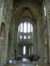 Photo: Now in the abbey church, looking down the 11th century Romanesque nave towards the Flamboyant Gothic choir, built after the end of the Hundred Years War. Construction began in the mid-15th century, but was not completed until 1521.