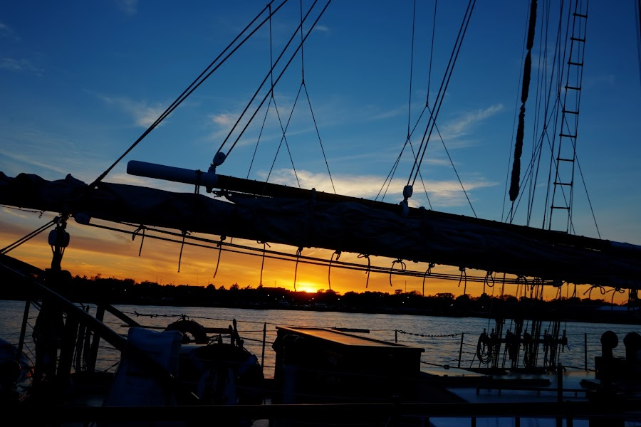 Sunset Boat Silhouette by Justin Kime - Transportation Boats ( orange, blue, silhouette, sunset, sailboat, boat,  )