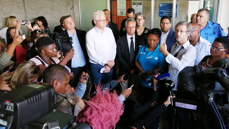 Western Cape preimer Alan Winde, centre, at a Tygerberg Hospital media conference about the province's first coronavirus case on March 11 2020.
