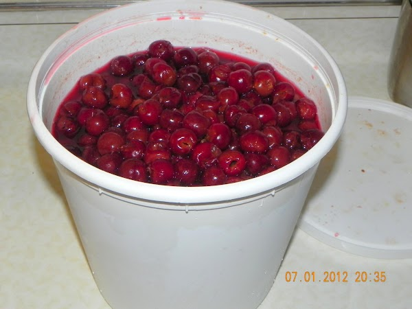 Start with a large bucket of pitted sour cherries.
