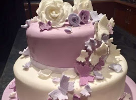 Lilac and white butterfly wedding cake