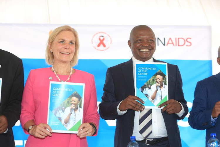UNAid's acting executive director Gunilla Carlson holds up UNAids' global Aids update report with SA deputy president David Mabuza in Eshowe, northern KwaZulu-Natal, on Tuesday.