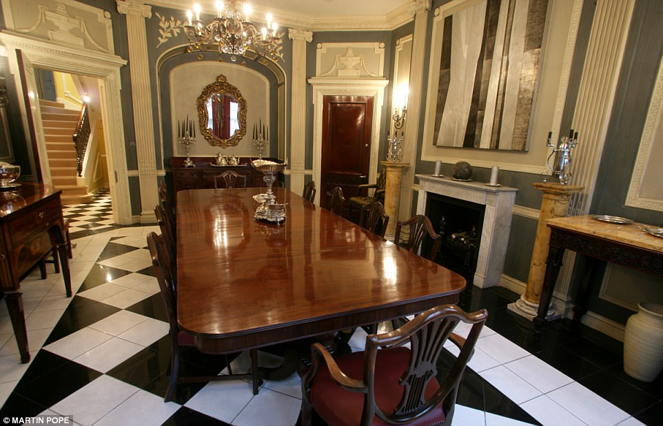 The Dining Room Has Marble Floors And Elaborate Moldings Notice Architraves Above Doors Foyer Seen Through Open Door Checkerboard