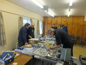 Photo: 005 Brian Guilmant briefs Ian Turner on strategy before the 009 Society opens for business whilst Lee Bryant has a quick rummage before the crowds arrive .