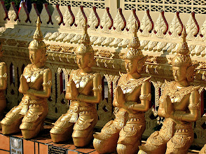 Photo: celestial beings (thep) surrounding the courtyard of Wat Si Thep