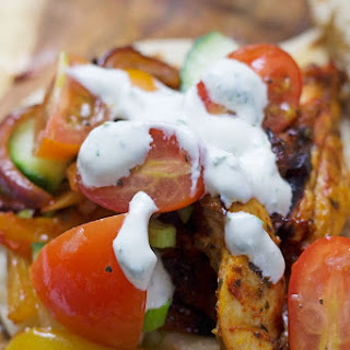 Sheet Pan Greek Chicken Flatbreads with Marinated Tomatoes and Herby Sour Cream Recipe