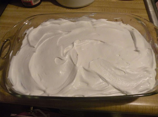 Spread Whipped Topping evenly over cooled cake.