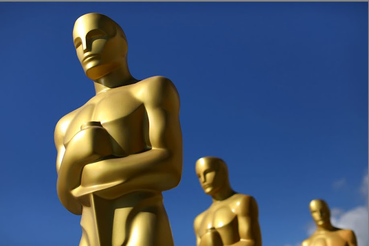 Oscar statues dry in the sunlight after receiving a fresh coat of gold paint. Picture: REUTERS/Mike Blake/File Photo