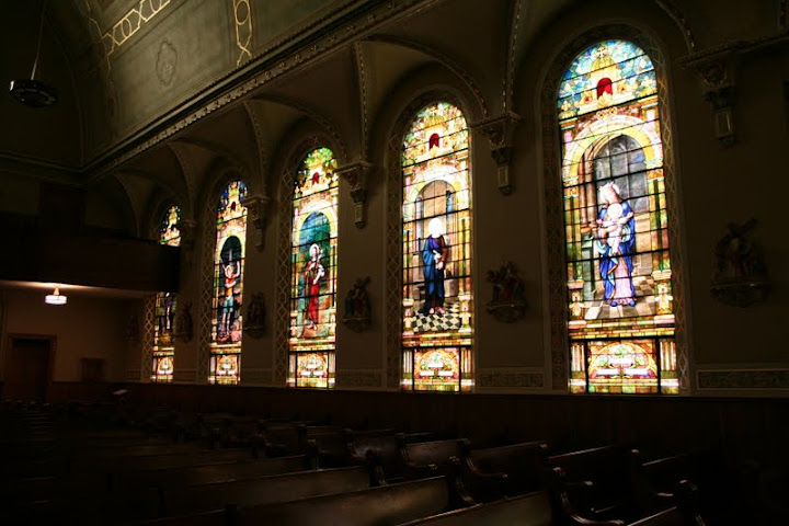 This is a photo taken in one of the churches in Calumet. The row of stain glass windows as well as all other ordinmentation demonstrates the wealth, commitment, and pride of a community. The church served a religious, social, and community based purpose within the town.-Ashley Holloway