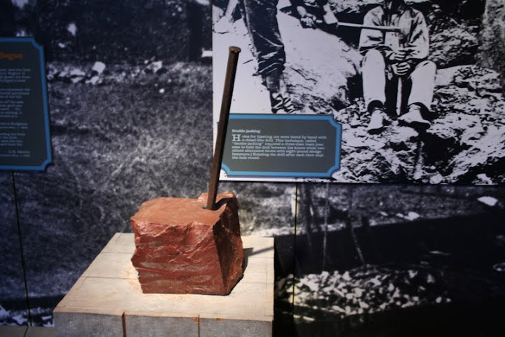 Example of a chisel located in the Michigan Mining Museum in Marquette. This was the pre cursor to the one or two man drill that was later developed. By using the chisel labor was long and strenuous as well as low production output. The one slight advantage to the chisel method however, was the fact that the dust control for health reasons was not as prominent of a factor.- Ashley Holloway