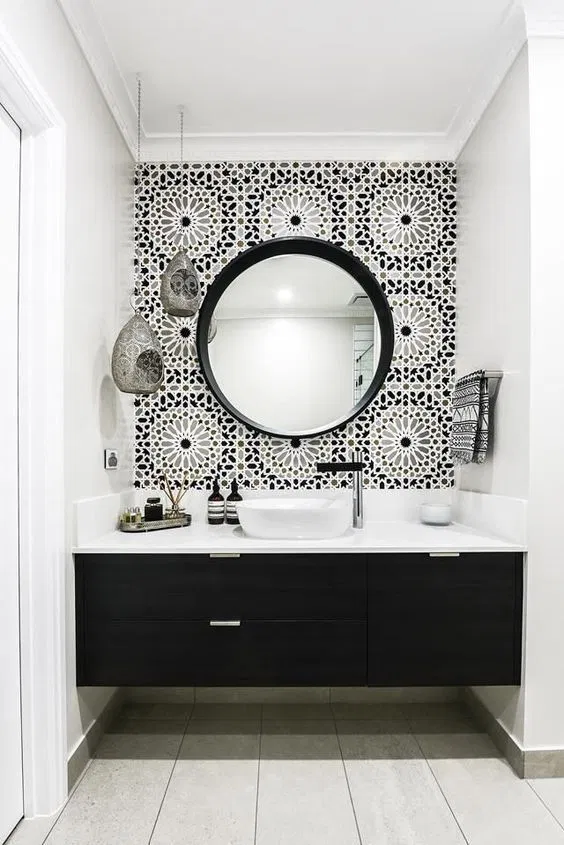 black and white contemporary bathroom with patterned wallpaper, black vanity, tile floors, white wall paint and modern white sink