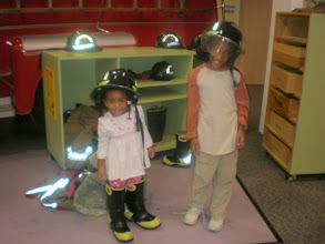 Photo: firefighters! the clothes absorbed the flash of the camera light. freaky effect!