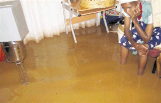 SODDEN SITUATION: Heavy rains that fell in most parts of Gauteng on Wednesday night flooded houses and destroyed furniture in GaRankuwa, near Pretoria. In parts of Soshanguve, residents had water in their houses that was knee high. Pic: Peggy Nkomo. 03/12/2009. © Sowetan.