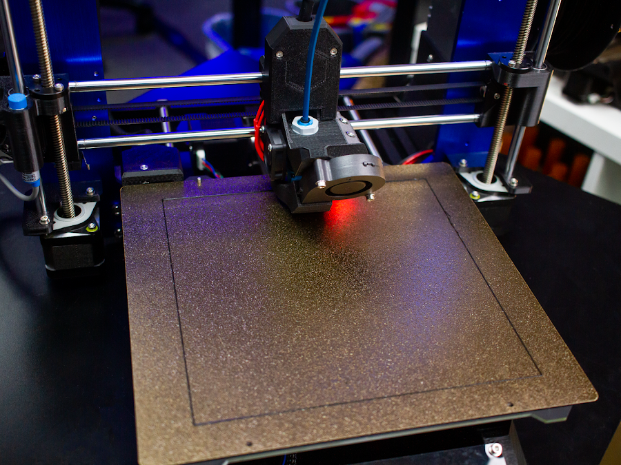 After using a bed probe (seen glowing red) you can 3D print across the entire bed of a 3D printer without worrying about high or low spots.