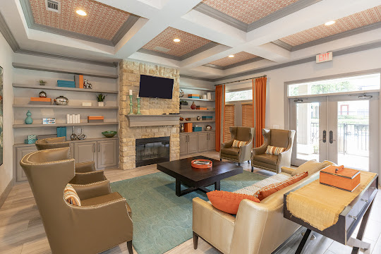 Clubhouse with couch, chairs, and fireplace