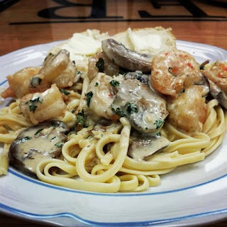 Shrimp and Mushroom Linguine with Creamy Cheese Herb Sauce.