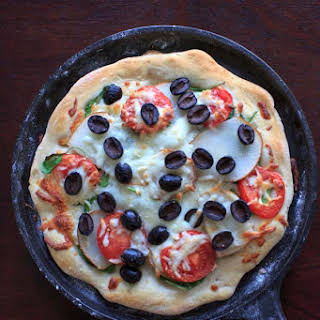 Homemade Pizza with Truffle Oil, Pear, Black Olives.