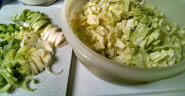Cut the green part and root off the leek, leaving just the white part....