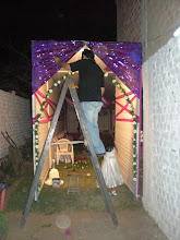 Photo: Ronald setting up, though I was the one who figured out how to get the arch to stay in place.