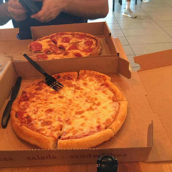 I could not choose between cheese and pepperoni.  Nima smiled.