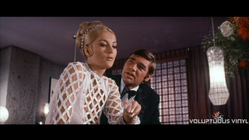 Barbara Bouchet smoking a cigarette wearing a see-through dress in Stoney.