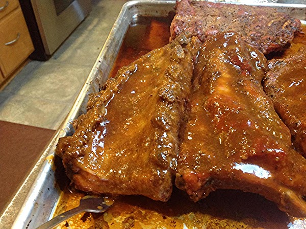 After first hour has elapsed, remove foil and baste ribs on both sides with...