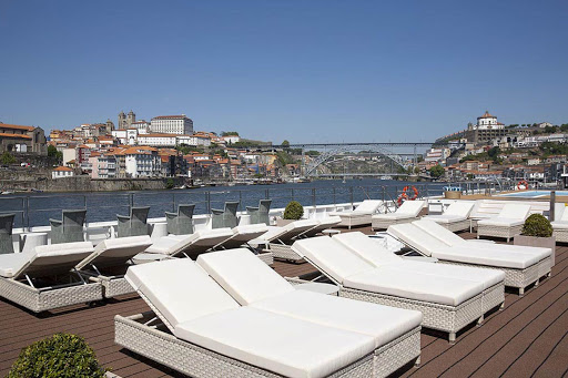 Take in the passing landscapes of the Douro Valley from the sun deck on Uniworld's S.S. Sao Gabriel.