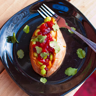 Sweet Potatoes Stuffed with Edamame and Ginger-Orange Cranberry Sauce.