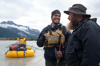 """Photo: Guides have a fun moment after long day while on raft trip down the Tashenshini River. The """"Tat"""" flows out of Yukon, CA, through British Columbia and empties into Glacier Bay National Park in Alaska, US."""