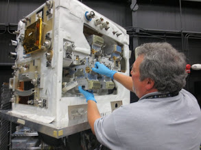 Photo: Ed pulling a component out of the Robotic Operating Simulator for Integration and Evaluation (ROSIE)