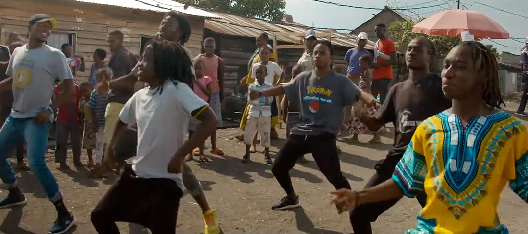 Image of Congolese dance group Street Dancers performing for onlookers