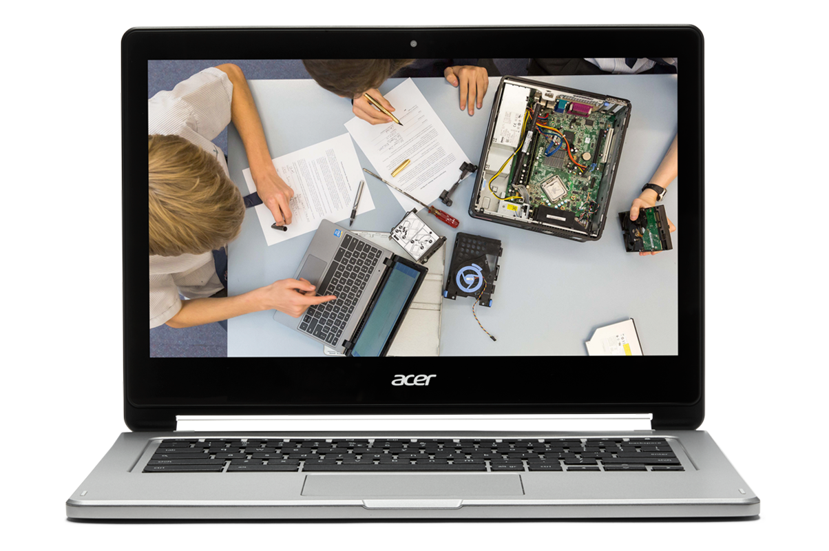 If you bring STEM to life in the classroom You Chromebook. Image of a Chromebook showing kids with a computer taken a part on a desk.