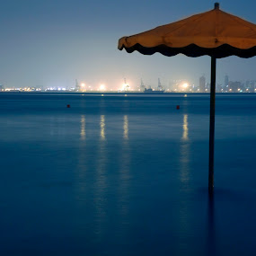 Umbrella by Tyrone de Asis - Landscapes Waterscapes ( umbrella, tary, manama.bahrain, sea, long exposure, waterscapes )