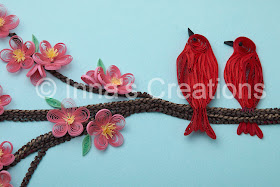 Quilled birds, sitting