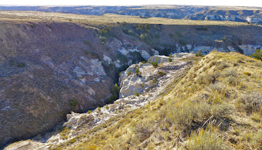 Photo: Looking down on Neat Coulee (the box canyon we had just walked through). Cliffs across the river from our campsite can be seen in the background (upper right of photo).