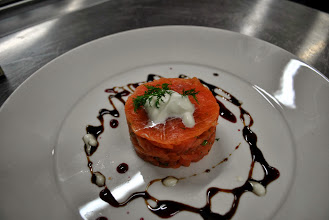 Photo: Smoked Salmon, marinated in rock salt, lime juice bound with creme fraiche. drizzled with a lemon, dill and honey oil dressing.