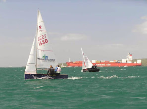 "Photo: #1530 ""Rhythm & Swing"" sailed by Brett & Penny Linton and #1322 ""Embers"" sailed by Jake & Ben Hawker"