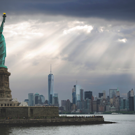 Liberty's Light by Christopher Pischel - Buildings & Architecture Statues & Monuments ( liberty, urban, skyline, statue, statue of liberty, urban landscapes, monument, cityscape, new york, nyc, new york city, city )
