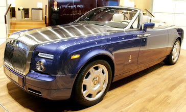 Photo: DETROIT - JANUARY 7:  The new Rolls Royce Phantom Drophead Coupe is revealed at the 2007 North American International Auto Show January 7, 2007 in Detroit, Michigan. The show draws nearly 7,000 members of the news media from around the world and opens to the public January 13.  (Photo by Bill Pugliano/Getty Images)   Original Filename: 72944321.jpg