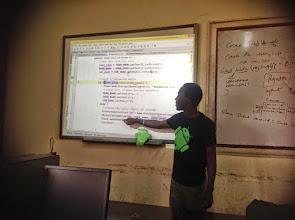 Photo: The facilitator explains a line of code