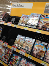"Photo: We walked around the electronics department a bit and then I saw that ""We Bought A Zoo"" was also in this area. I saw the prices and we pleasantly surprised to see that it was just $12.96 for the one I was buying. The blu-ray version was on rollback for $17.96. For me, saving $5 by buying the DVD version is worth it."