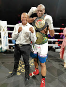 Promoter Lebo Mahoko and newly crowned SA and WBA Pan African middleweight champion Nkululeko Mhlongo celebrate their victory against Walter Dlamini./Nick Lourens