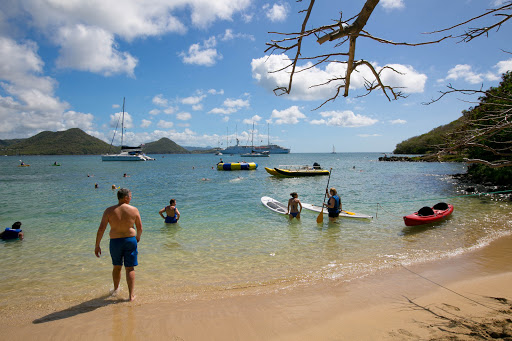 st-lucia-beach-party.jpg - Windstar passengers take advantage of kayaks, watercraft and other sports equipment during a beach barbecue in St. Lucia.