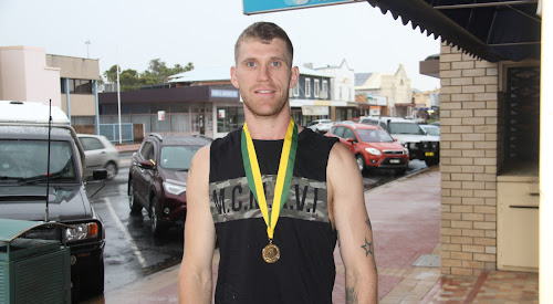 Brendan Davey with his Australian Amateur Boxing League gold medal.