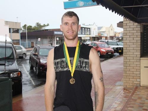 Brendan Davey with his Australian Amateur Boxing League gold medal.