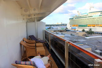 Photo: The starboard side part of the wrap around verandah.  We moved the chairs here to take advantage of the cover along here.  There is virtually no cover on the aft portion of the verandah.