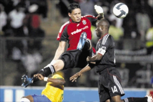 ANIOUS MOMENT: Bucs Moeneeb Josephs and Lucky Lekgwathi at sixes and sevens against Katlego Mphela during Sundowns 2-0 win at Atteredgeville Stadium last night. Pic: ANTONIO MUCHAVE. 25/11/2009. © Sowetan.