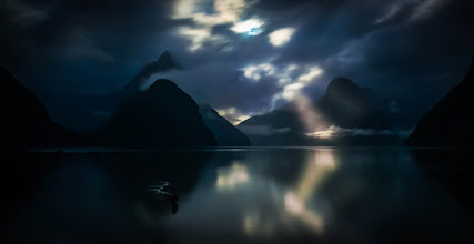 Photo: Taken a few minutes ago... Moonlight over Milford Sound  Just got back to the Milford Sound lodge... processing photos with Tom... the rain stopped a few hours ago and the moon came out to peek between to clouds in the fjord.  (now to sleep to wake up at 5:40 AM for sunrise shots!) :)