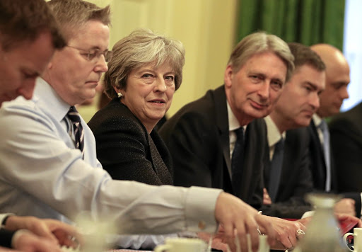 Battleground: Britain's Prime Minister, Theresa May, leads her first cabinet meeting of the new year following a reshuffle at 10 Downing Street, London, on Tuesday. A stand-off between Britain and the EU over future access to the single market for London's vast financial services industry is shaping up to be one of the key Brexit battlegrounds before Britain is due to leave the bloc in March 2019. Picture: REUTERS